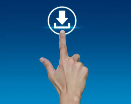 pushing button: Hand pushing button web download icon over blue background