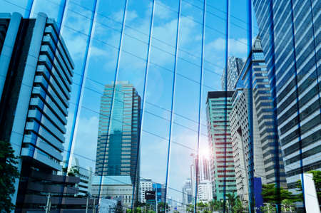 reflect: Reflect of modern city tower on metal wall, Bangkok Thailand