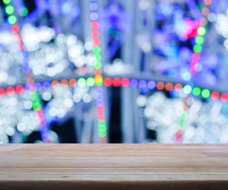 colorful light display: Empty wooden table over blurred light colorful bokeh background, for product display Stock Photo