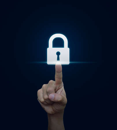 Hand pressing security key button on virtual screen, Technology information security and data encryption concept Imagens