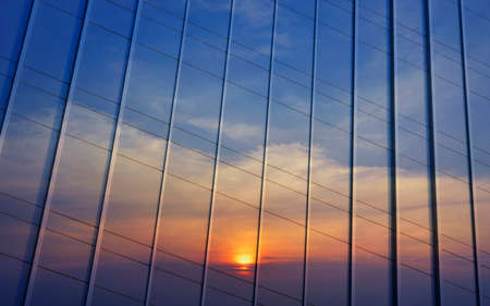 sky reflection: Reflection of sunset sky in metal wall of office building Stock Photo