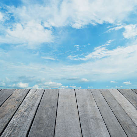 old wood floor: Empty old wood floor with blue sky with white clouds, for your product display montage Stock Photo