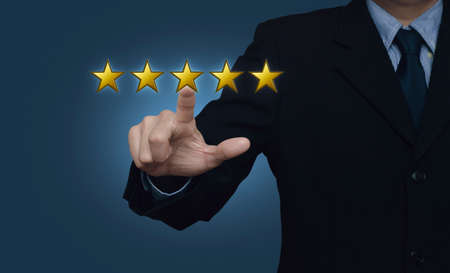 five stars: Businessman pressing five yellow stars to increase rating on blue background, Feedback concept