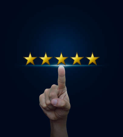 Hand click on five yellow stars to increase rating on blue background, Feedback concept