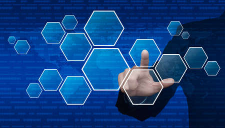 cryptogram: Businessman hand pushing blank hexagon shape virtual technology screen over computer binary code with digital world map