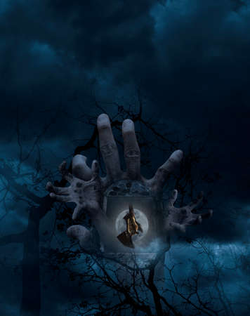 over the moon: Double exposure of hand blend with ancient window and stone texture with bat scream and hang over moon, dead tree and cloudy sky, Halloween abstract concept Stock Photo