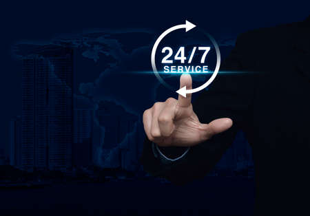 Businessman pressing button 24 hours service icon over map and city tower, Full time service concept, Elements of this image furnished by NASA