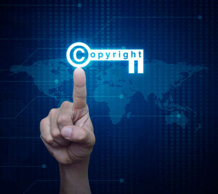 patents: Hand pressing copyright key icon over digital world map technology style, Copyright and patents concept, Elements of this image furnished by NASA Stock Photo