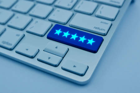 Five stars on modern computer keyboard button, Increase rating, Feedback business concept, blue tone