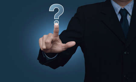 point d interrogation: Businessman pressing question mark sign icon over blue background, Customer support concept