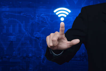 cocaine: Businessman pressing wi-fi icon over map and city background, Technology and internet concept, Elements of this image furnished by NASA