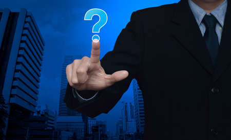 point d interrogation: Businessman pressing question mark sign icon over city tower background, Customer support concept