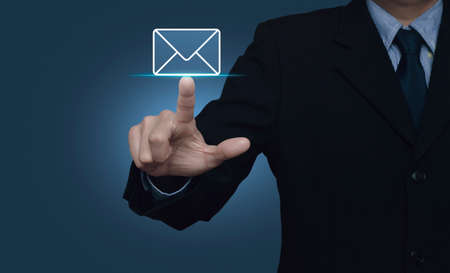 e commerce icon: Businessman pressing mail flat icon over gradient light blue background, Contact us concept Stock Photo