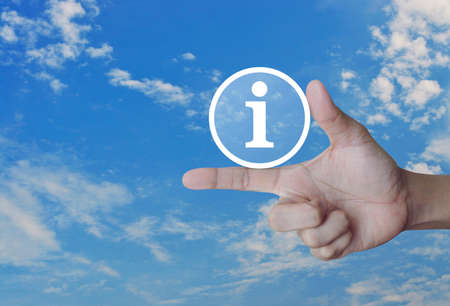 answer: Information sign icon on finger over blue sky, Business communication concept