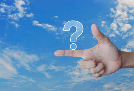 Question mark sign icon on finger over blue sky, Customer support concept Banque d'images