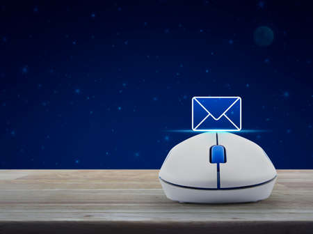 Mail flat icon with wireless computer mouse on wooden table over fantasy night sky and moon, Business contact us concept