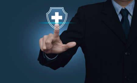 Businessman pressing cross shape with shield flat icon over gradient light blue background, Business healthy and medical care insurance concept