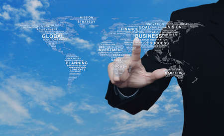 Businessman pressing global business words world map over blue sky with white clouds, Elements of this image furnished by NASA