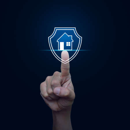 Hand pressing house with shield flat icon over gradient blue background, Business home insurance and security concept Reklamní fotografie - 121739121