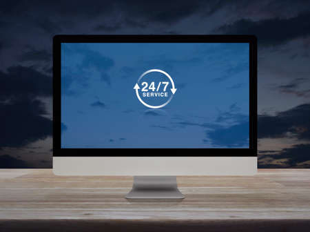 24 hours service flat icon on desktop modern computer monitor screen on wooden table over sunset sky, Business full time service online concept