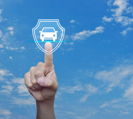 Hand pressing car with shield flat icon over blue sky with white clouds, Business automobile insurance concept Banco de Imagens - 122756942