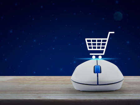 Shopping basket flat icon with wireless computer mouse on wooden table over fantasy night sky and moon, Business shop online concept
