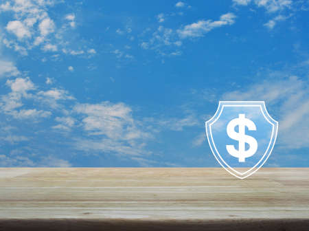 Dollar with shield flat icon on wooden table over blue sky with white clouds, Business money insurance and protection concept