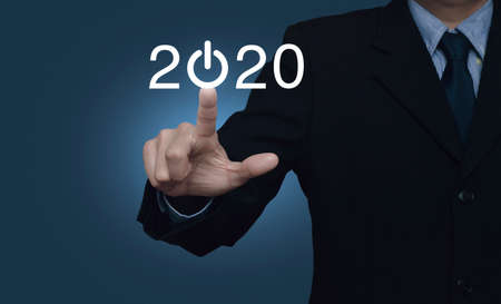 Businessman pressing 2020 start up business flat icon over gradient light blue background, Business happy new year cover concept