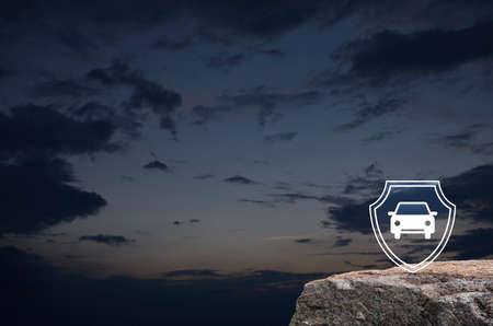 Car with shield flat icon on rock mountain over sunset sky, Business automobile insurance concept