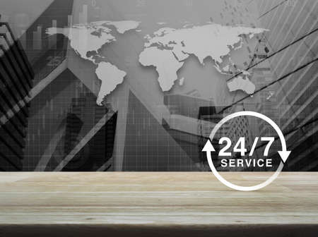 24 hours service icon on wooden table over black and white world map, city tower and skyscraper background, Business full time service concept