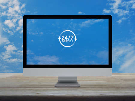 24 hours service flat icon on desktop modern computer monitor screen on wooden table over blue sky with white clouds, Business full time service online concept