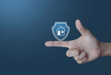 Hand pressing house with shield flat icon over light gradient blue tone background, Business home insurance and security concept