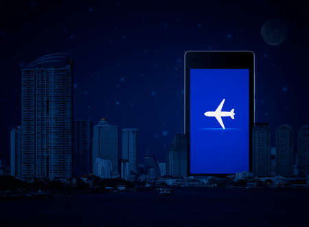 Airplane flat icon on modern smart mobile phone screen over office city tower, river, skyscraper and fantasy night sky, Business plane transportation online concept