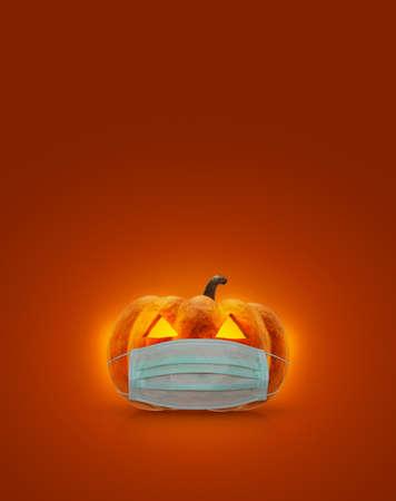 Halloween jack o lantern pumpkin wearing medical face mask on orange background, Halloween