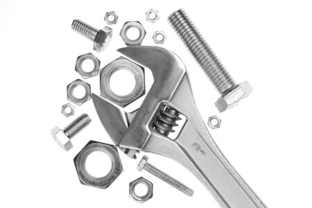 Adjustable work wrench with nuts and screws Stock Photo
