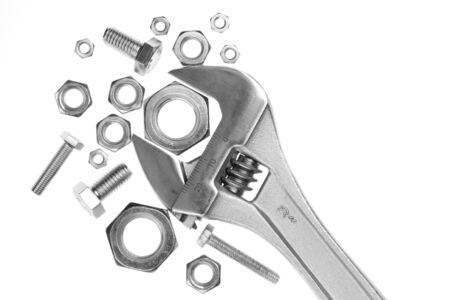 Adjustable work wrench with nuts and screws photo