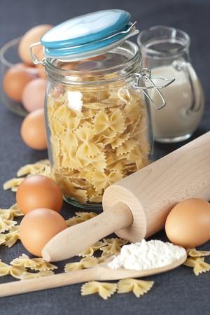 Glass jar with farfalle pasta photo