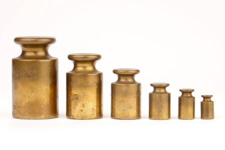 antique weight scale: A row of weights Stock Photo