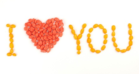 Inscription I Love You arranged with dragees of peanuts photo