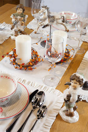 christmas table set with sculptures photo