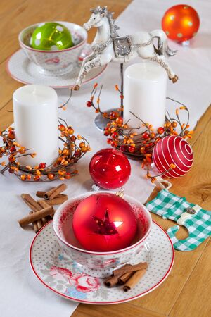 christmas table set with candles and balls photo