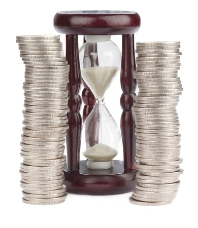 Hourglass and Euro coins Stock Photo - 12983874