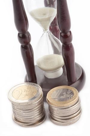Hourglass and Euro coins photo