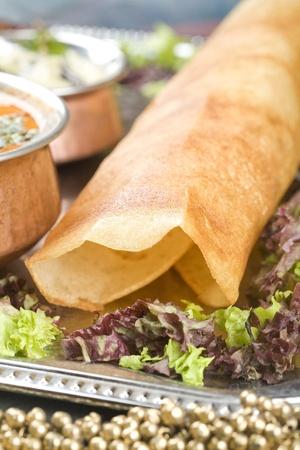 masala: Dosa con los ingredientes, plato indio del Sur Foto de archivo