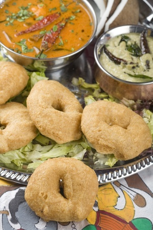 fritters: Indian food, Medhu Vada, Lentil fritters Stock Photo