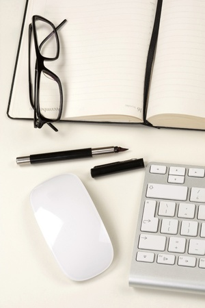 Businessman desk with notebook, glasses, pen, mouse and keyboard Stock Photo - 13330986