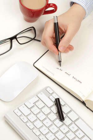 Woman s hand writes in a notebook Stock Photo - 13330988