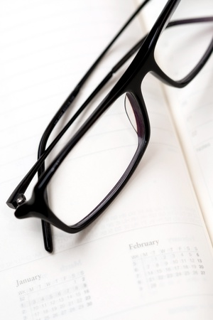 Glasses and paper notebook Stock Photo - 13330985