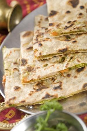 Punjabi Parantha stuffed with vegetables. Stock Photo