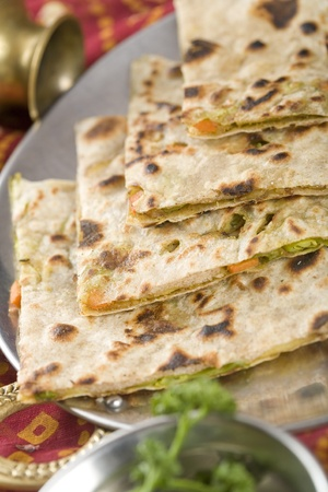 Punjabi Parantha stuffed with vegetables. Stock Photo